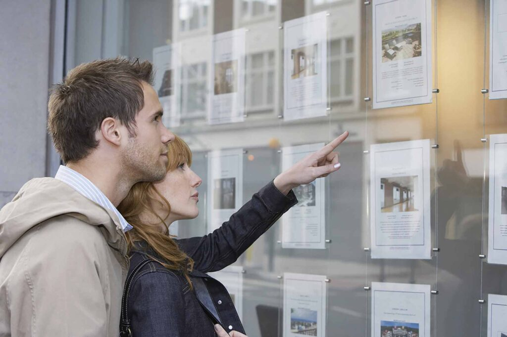 young couple looking at house needing Residential & Commercial Conveyancing